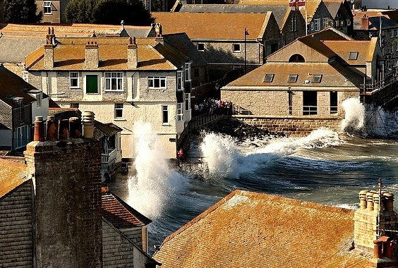 High waves crashing into the sea wall in St. Ives, Cornwall, England