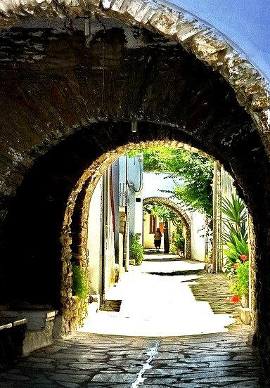 Paved alley and arches in Steni, Tinos island, Greece
